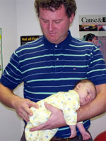 Kelowna Chiropractor adjusts a baby